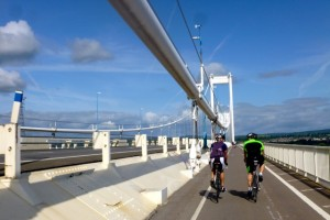 riders crossing the severn bridge