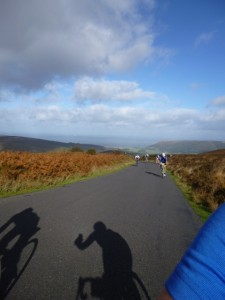 riders behind sunshine ahead