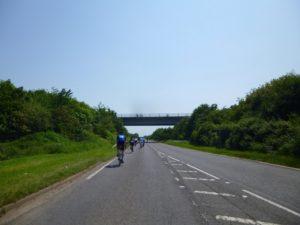 riders on the bridge riders below